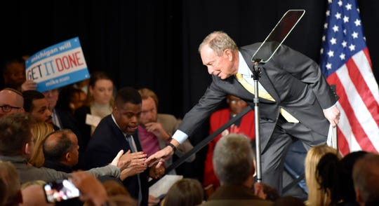 Democratic presidential candidate Mike Bloomberg shakes hands after he speaks to more than 450 supporters in Detroit's Eastern Market.