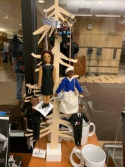 A performing arts center at Michigan State University removed a gift shop display featuring dolls depicting prominent black figures that were hanging from a tree-like rack, said school officials