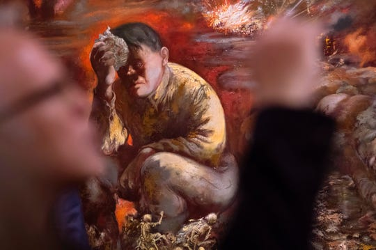 """The 1944 painting depicts a broken Hitler sitting among skeletons as war rages behind him, and helps illustrate """"how Grosz further developed his critical form after emigration,"""" said Markus Hilgert, a senior German cultural official."""