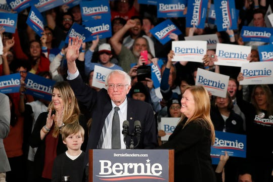 Democratic presidential candidate Sen. Bernie Sanders, I-Vt., with his wife Jane O'Meara Sanders, right, and other family members, speaks at a caucus night campaign rally in Des Moines, Iowa, Monday, Feb. 3, 2020.