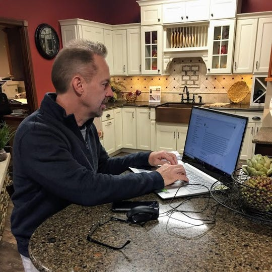 Mike Shadoan, owner of Radiant Windows reads a customer review on Angie's List. He responds to each review.
