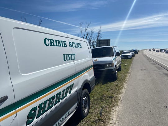 Members of the Lee County Sheriff's Office conduct an investigation along I-75 near the Caloosahatchee Bridge on Tuesday, Feb. 4, 2020. They were reportedly looking for evidence related to a homicide at a south Fort Myers apartment complex