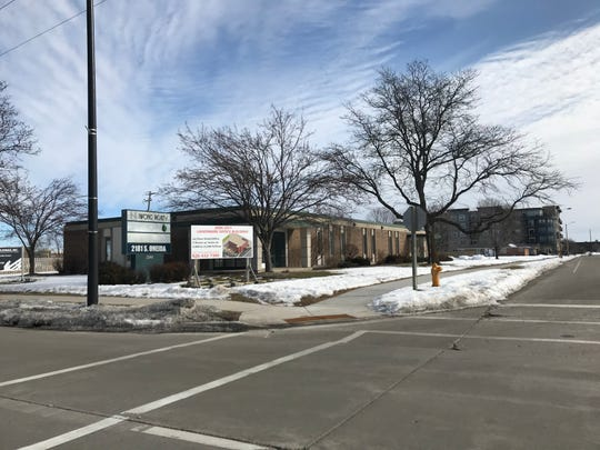 Nifong Realty plans to redevelop its existing office building at 2181 S. Oneida St., on the northeast corner of Oneida Street and Marvelle Lane.  The plan calls for a four story, red brick office building that would have room for multiple tenants.
