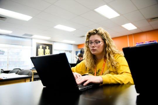 Jordon Holcombe, a senior at Carolina High School, uses her laptop during class Monday, Feb. 3, 2020.