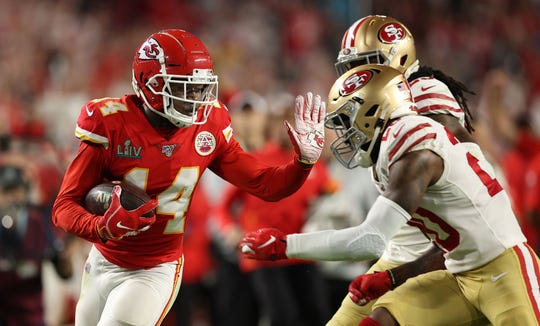 Kansas City Chiefs wide receiver Sammy Watkins (14) gets ready to stiff arm San Francisco 49ers free safety Jimmie Ward (20) on a catch in the fourth quarter of Super Bowl LIV at Hard Rock Stadium in Miami Gardens, Feb. 2, 2020.  [ALLEN EYESTONE/The Palm Beach Post]