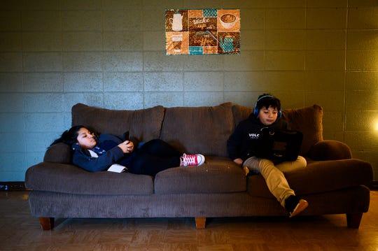 Sixth-graders Martiza Rangel, left, and Edwin Lima-Martinez, take a break while at Neighborhood Focus at Berea Heights Baptist Church Monday, Jan. 27, 2020.