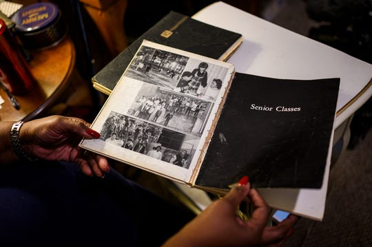 Barbara Franklin looks through a copy Beck High School of the class of 1970 yearbook. An abbreviated version of the yearbook was printed in limited quantities for the senior class at Beck, who moved to different schools during the school year.