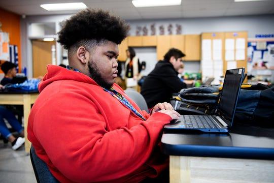 Senior Jordan Austin uses his laptop during class at Carolina High School Monday, Feb. 3, 2020.