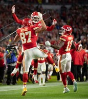 Kansas City Chiefs tight end Travis Kelce (87) celebrates a touchdown reception Kansas City Chiefs wide receiver Sammy Watkins (14) and Kansas City Chiefs wide receiver Byron Pringle (13) in the fourth quarter of Super Bowl LIV at Hard Rock Stadium in Miami Gardens, Feb. 2, 2020.  [ALLEN EYESTONE/The Palm Beach Post]