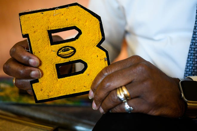 Ernest Hamilton holds his Beck High School varsity letter. Hamilton was part of the last graduating class at Beck before Greenville County Schools integrated in 1970.
