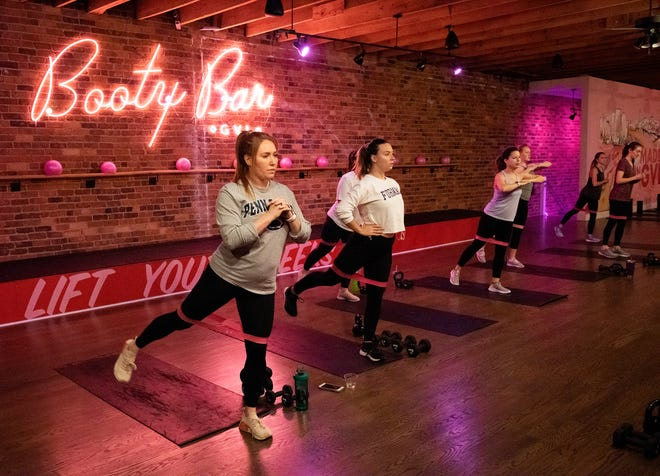 An workout class is held at The Booty Shop in downtown Greenville.