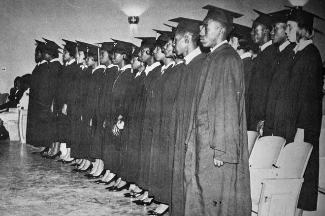 The first graduating class of Beck High School is pictured in this photograph displayed in a Beck yearbook.
