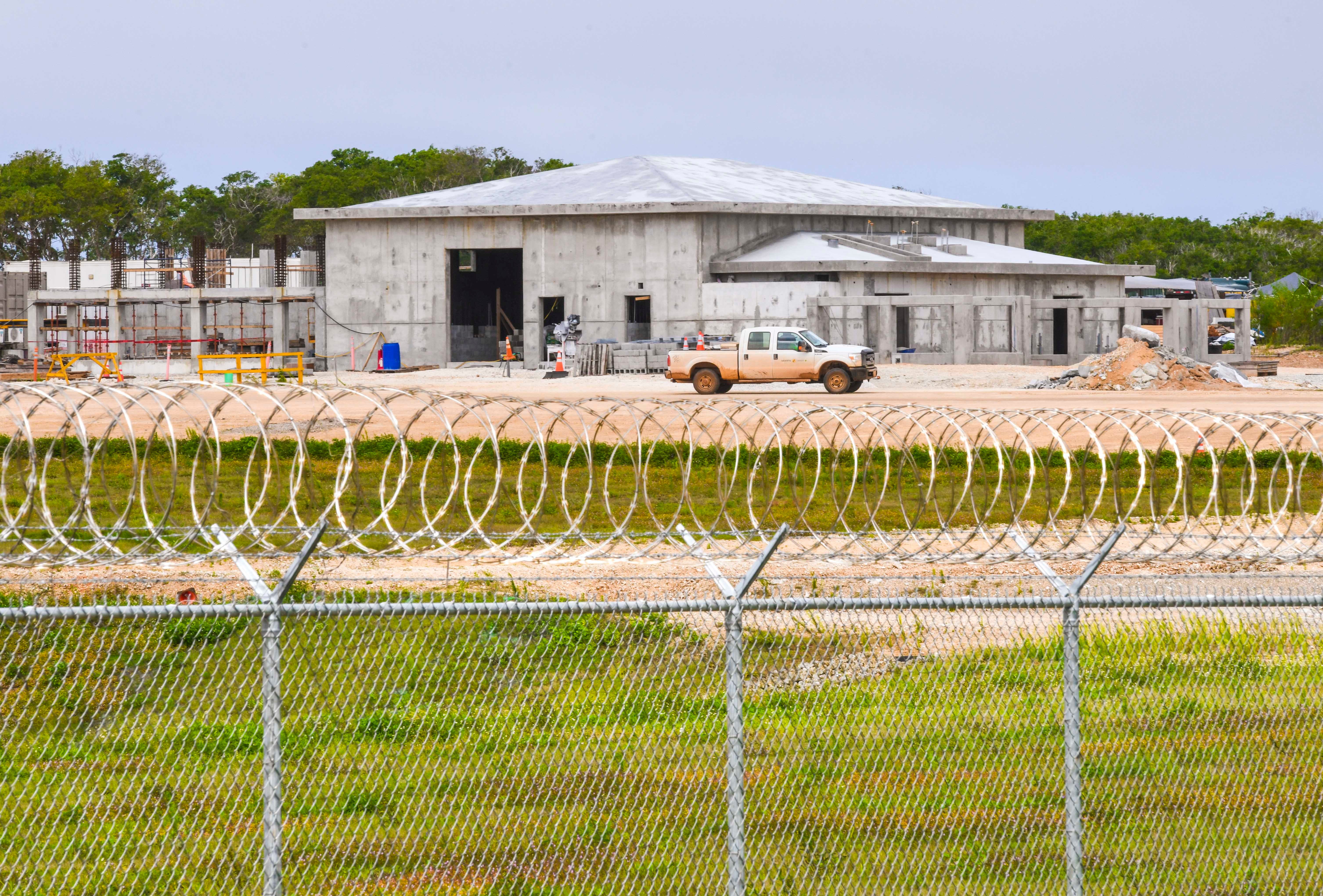 Construction of military facilities continues behind a perimeter fence running along Route 3 in Dededo on Tuesday, Feb. 4, 2020.