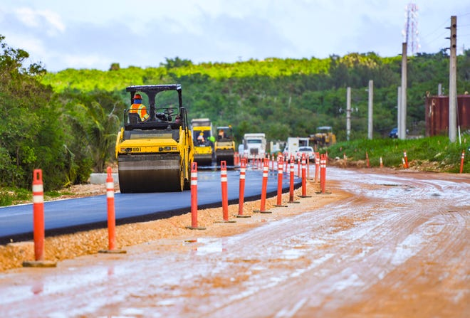 Hawaiian Rock Products employees operate steamrollers to compress a layer of asphalt on a section of Route 3A on Tuesday, Feb. 4, 2020, near an area of Dededo where the military has been constructing improvements to its facilities.