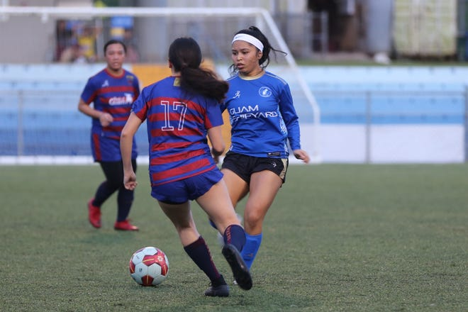 Guam Shipyard Women's Hannah Cruz opts to pass the ball against the Bank of Guam Lady Strykers during a Week 8 Premier Division match of the Bud Light Women's Soccer League Sunday at the Guam Football Association National Training Center. Guam Shipyard Women defeated the Lady Strykers 2-1.