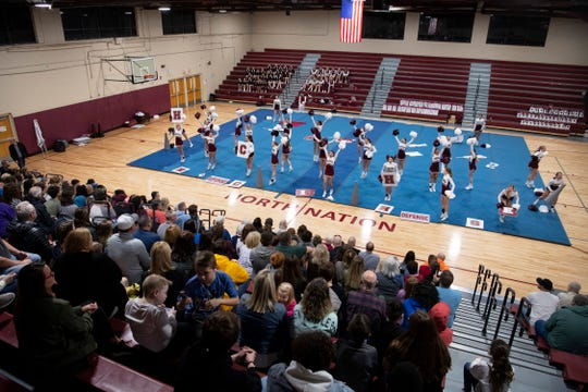 The Henderson County High School girls cheer squad performs at North Middle School Monday night, Feb. 3, 2020. HCHS and North Middle School will be sending a total of 62 students to Orlando, Fla., to compete in the national championships.