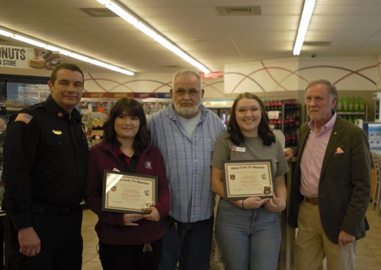 Madison County Fire Chief Eric Turner, Speedway employee Alisiya Deschaine, customer Daryl Garland, Speedway employee Sierra Voris and Madison County Mayor Jimmy Harris pose at Speedway on Christmasville Road in Jackson, Tenn., on Feb. 4, 2020. Deschaine and Voris received certificates and challenge coins for providing first aid to Garland.