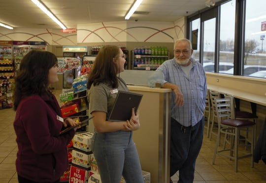 Speedway gas station employees Alisiya Deschaine, left, and Sierra Voris, middle, talk with regular customer Daryl Garland at Speedway on Christmasville Road in Jackson, Tenn., on Feb. 4, 2020. Deschaine and Voris received certificates and challenge coins from the Madison County Fire Department for providing first aid to Garland when he suffered a varicose vein rupture at the store.