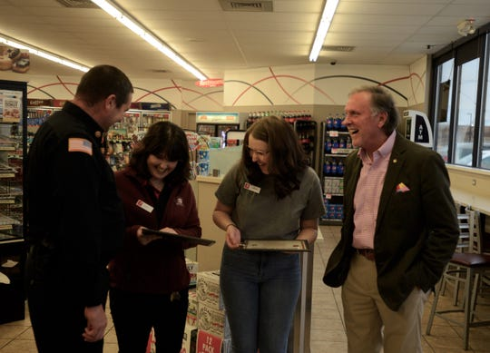 Madison County Fire Chief Eric Turner, Speedway employee Alisiya Deschaine, Speedway employee Sierra Voris and Madison County Mayor Jimmy Harris laugh together at Speedway on Christmasville Road in Jackson, Tenn., on Feb. 4, 2020. Deschaine and Voris received certificates and challenge coins for providing first aid to a customer.
