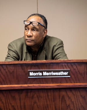 District 6 Mr. Morris Merriweather listens in during a meeting on Feb. 3.