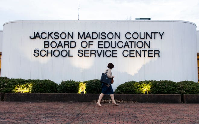 District 5 Shannon Stewart walks towards the Jackson-Madison Board of Education building for a special call meeting in Jackson, Tenn., Feb. 3, 2020.