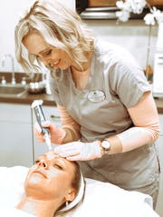 Facial treatments, like this one pictured in January 2020, are a big part of Amber Boone's day. She became the first professional in Tennessee to complete the masters seminar in CoolSculpting, the practice of eliminating stubborn fat by freezing the fat cells.
