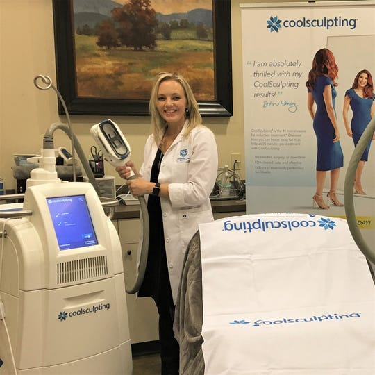 Amber Boone, in this January 2020 photo, shows the machine used in CoolSculpting.