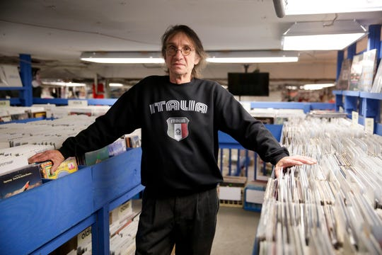 Jim Pasdach, owner of JL Records, stands for a portrait inside his store, Tuesday, Feb. 4, 2020 in West Lafayette.