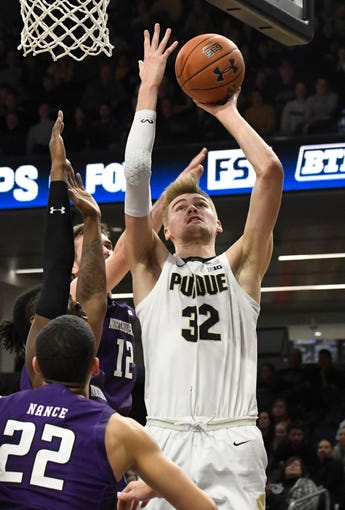 Feb 1, 2020; Evanston, Illinois, USA; Purdue Boilermakers center Matt Haarms (32) shoots the ball over Northwestern Wildcats forward Pete Nance (22) during the second half at Welsh-Ryan Arena. Mandatory Credit: David Banks-USA TODAY Sports