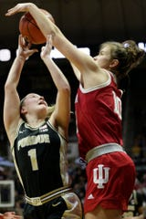 Indiana forward Aleksa Gulbe (10) blocks Purdue guard Karissa McLaughlin (1) during the first quarter of a NCAA women's basketball game, Monday, Feb. 3, 2020 at Mackey Arena in West Lafayette.