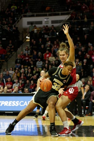 Purdue forward Ae'Rianna Harris (32) drives against Indiana forward Aleska Gulbe (10) during the second quarter of a NCAA women's basketball game, Monday, Feb. 3, 2020 at Mackey Arena in West Lafayette.
