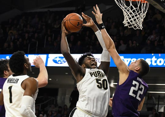 Feb 1, 2020; Evanston, Illinois, USA; Purdue Boilermakers forward Trevion Williams (50) shoots over Northwestern Wildcats forward Pete Nance (22) during the second half at Welsh-Ryan Arena. Mandatory Credit: David Banks-USA TODAY Sports