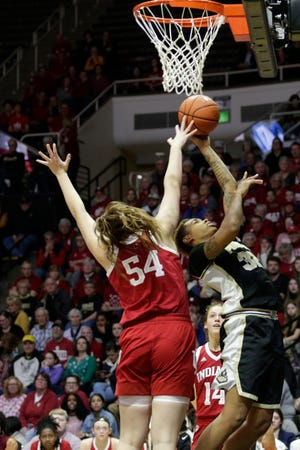 Purdue forward Ae'Rianna Harris (32) goes up for two against Indiana forward Mackenzie Holmes (54) during the second quarter of a NCAA women's basketball game, Monday, Feb. 3, 2020 at Mackey Arena in West Lafayette.