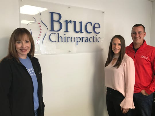 Pictured is the staff of Bruce Chiropractic at 118 E. Main St. On the far left is office manager Michelle Jeffrey, with co-owners Dr. Kate Bruce and Justin Bruce on the right.