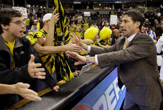 Wake Forest coach Dino Gaudio high-fives fans after a win over Indiana in 2008.