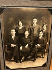 Do you know who these people are? David Marshall of Cambridge, Minnesota, owns this photo and three others, and he'd like to learn more about the people in it.