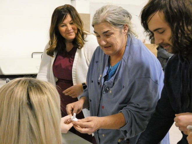Teresa Flohr, center right, learns how to use Narcan at a pop-up clinic at the Salvation Army on Monday. Marion Public Health is holding pop-up clinics to distribute Narcan kits and educate people on how to use the overdose-reversing drug.
