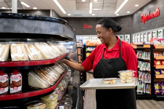 Adi Tessema stocks grab-and-go items including deviled eggs and sandwiches Tuesday, Feb. 4, 2020, at The One in Memphis.