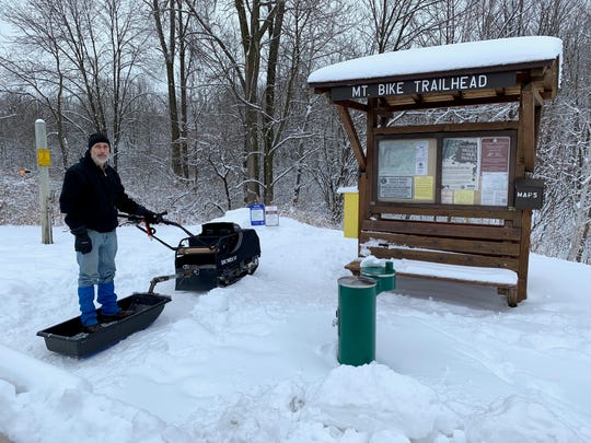 Walter Hougas, a Friends of Blue Mound State Park trail steward, stands behind a Snowdog he uses to compact the fat-tire bike trails at the park.