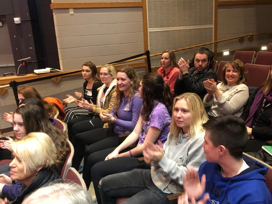 """Milton High School freshman Baily Ratzburg, third from the left in the middle row, sits with friends in her school's """"Raise Your Voice"""" group."""