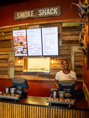 Smoke Shack Express employee Nevaeh West takes orders at the Wauwatosa restaurant's new counter. The restaurant is at 11340 W. Burleigh St.