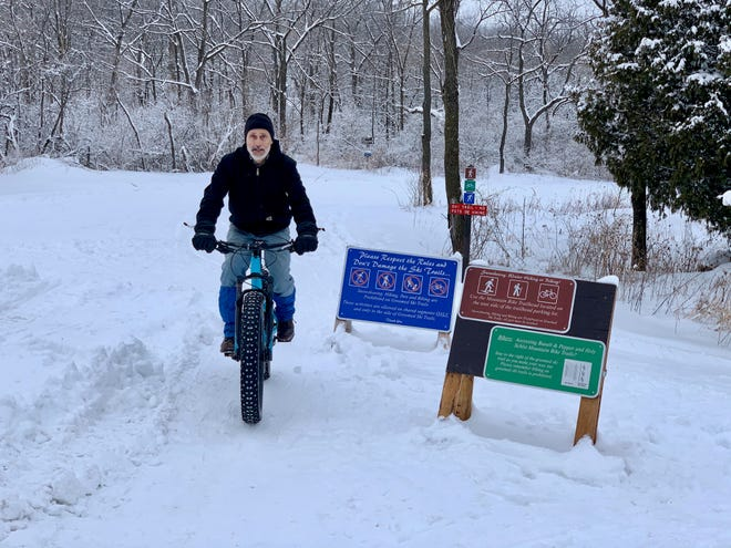 Walter Hougas, a Friends of Blue Mound State Park trail steward, rides a fat-tire bike at the park.