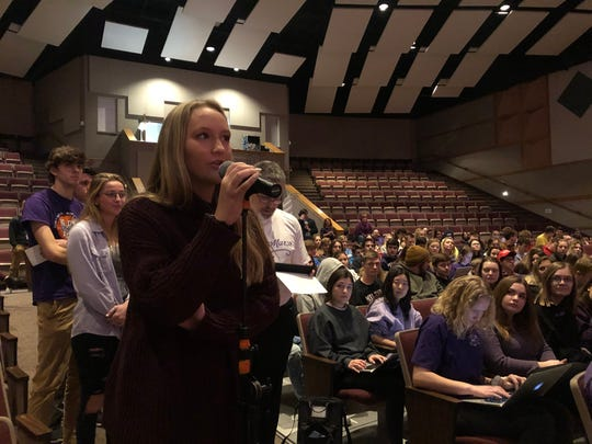Alyssa Holmes, a senior at Milton High School, asks Gov. Tony Evers for advice for future educators like herself. Evers took questions from students after signing a bill providing funding for school-based suicide prevention programs.
