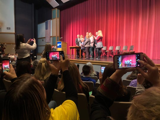 Students and teachers at Milton High School take photos as Gov. Tony Evers approves a new grant program for suicide prevention programs.