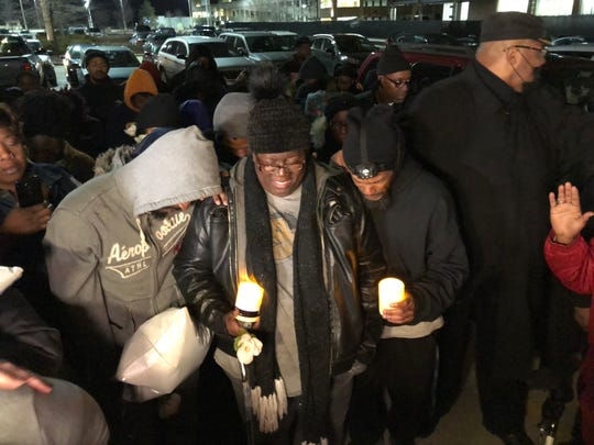 Tracy Cole, middle, speaks about her son Alvin during a vigil for him Monday, Feb. 3, 2020, in The Cheesecake Factory parking lot in Wauwatosa, a day after he was shot and killed by a Wauwatosa police officer.