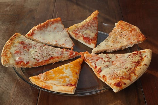 Tasters tested six take-and-bake pizzas from area grocery stores in Milwaukee. Starting at 12 O'clock and then moving clockwise are Meijer, Sendik's, Walmart, Piggly Wiggly, Aldi and Kwik Trip.