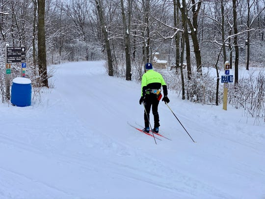 A cross-country skier makes his way down a trail at Blue Mound State Park.