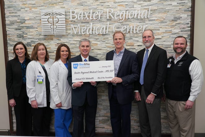 Baxter Regional Medical Center recently received a $149,997 grant from the Blue & You Foundation to improve its Virtual ICU equipment. Shown above are (from left) Rebecca Pittillo, Associate Executive Director, Blue & You Foundation for a Healthier Arkansas; Susan Musgrove, CSICU Nurse Director, Baxter Regional Medical Center;  Shannon Nachtigal, VP/Chief Nursing Officer, Baxter Regional Medical Center ; Curtis Barnett, President and Chief Executive Officer, Arkansas Blue Cross and Blue Shield;  Ron Peterson, President and Chief Executive Officer, Baxter Regional Medical Center;  Cal Kellogg, EVP and Chief Strategy Officer, Arkansas Blue Cross and Blue Shield; and Justin Woods, Gift Officer, Baxter Regional Hospital Foundation.