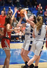 Cotter's Kate Cheek goes up for two of her 36 points against Lead Hill on Monday night.