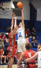 Cotter's Hayden Hutson puts up a shot against Lead Hill on Monday night.